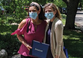 Dr. Chittle Shubeck (right) with Dr. Christie Youssef at drive-by graduation
