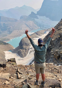 "Dr. Glenn celebrates on a 14-mile hike with a 2,600-foot elevation change in Glacier National Park in Montana. ""Hiking reminds me that anything really is possible,"" he says"