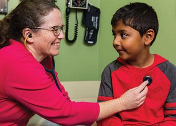 Dr. Sinda Althoen with a patient