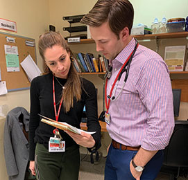 CAP fellow Dr. Rebecca Fein (left) discusses a case at Weill Cornell Medical College with pediatrics resident Dr. Eric Wilsterman.