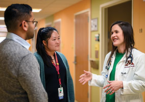 Dr. Emily Borman-Shoap (right) shares her expertise with Chief Resident Dr. Vishal Naik (left) and third-year resident Dr. Sandy Liu (center). Photo by Aaron Lavinsky.