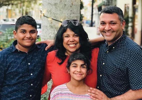Dr. Sapna Kudchadkar with her son Kishen (15), daughter Asha (12), and husband Raj